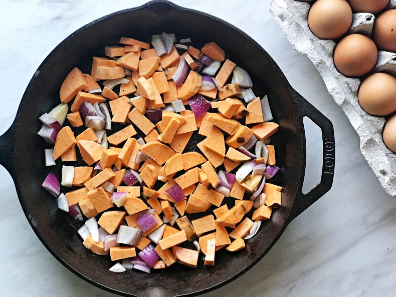 skillet with sweet potatoes and onions