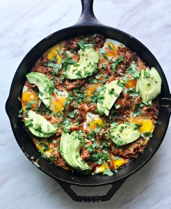 bbq chicken egg skillet with avocado and chopped cilantro