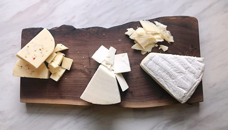 Step 1: Arrange variety of cheeses on serving board or plate