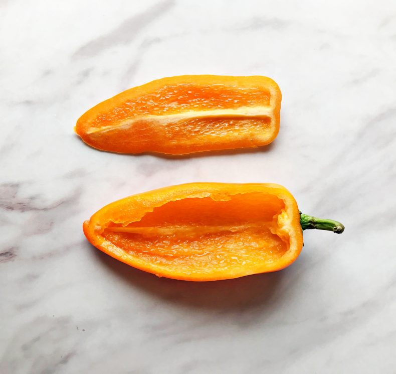 orange mini bell pepper cut long ways to create a boat