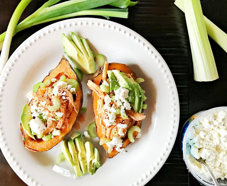 sweet potatoes stuffed with buffalo chicken and topped with scallions, celery, feta, and avocado