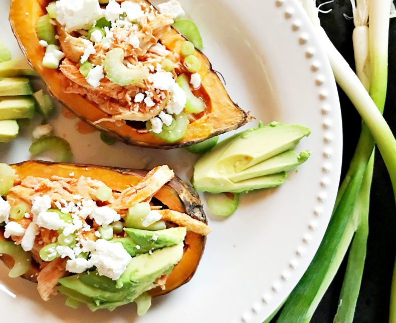 shredded buffalo chicken inside baked sweet potato, topped with scallions, celery, avocado, and feta cheese