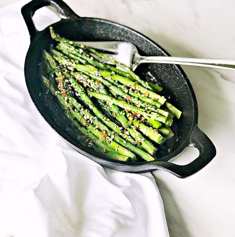 baked asparagus with seasoning on top ready to eat