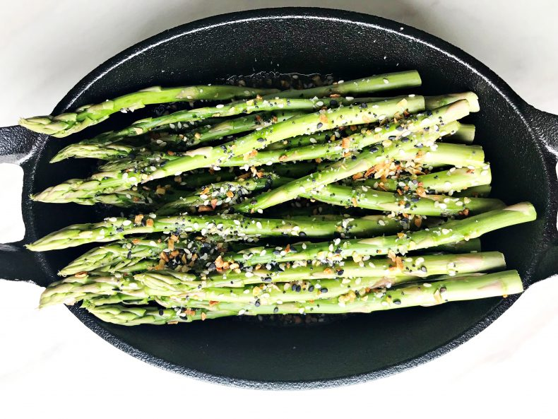 asparagus in skillet with seasoning