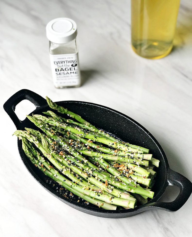 asparagus in skillet with oil and seasoning