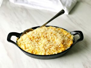 creamy macaroni and cheese in skillet with buttery panko topping