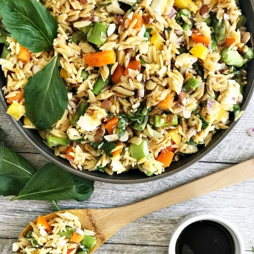 orzo salad with wooden spoon and balsamic dressing